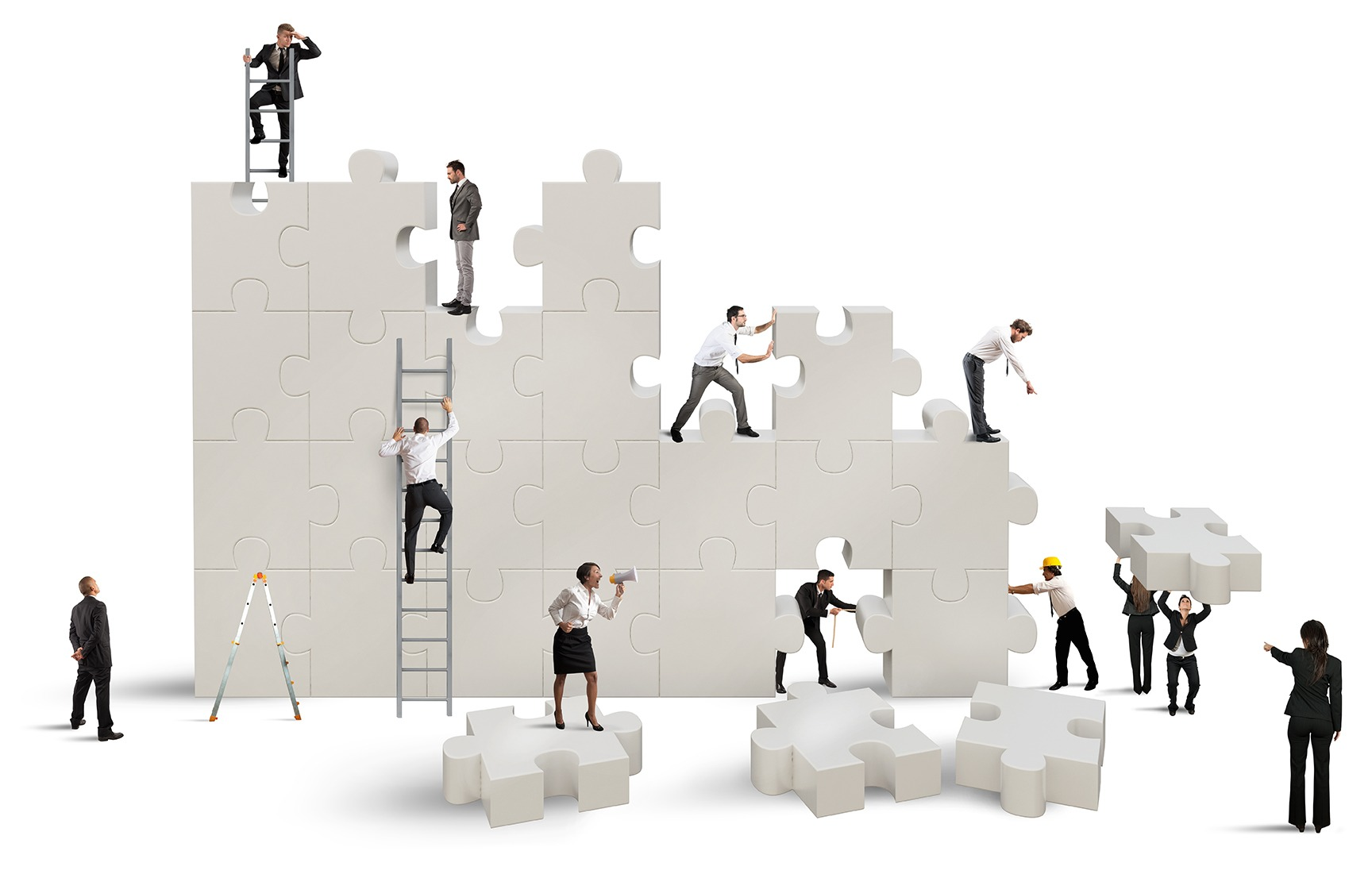 Small people building a jigsaw like structure