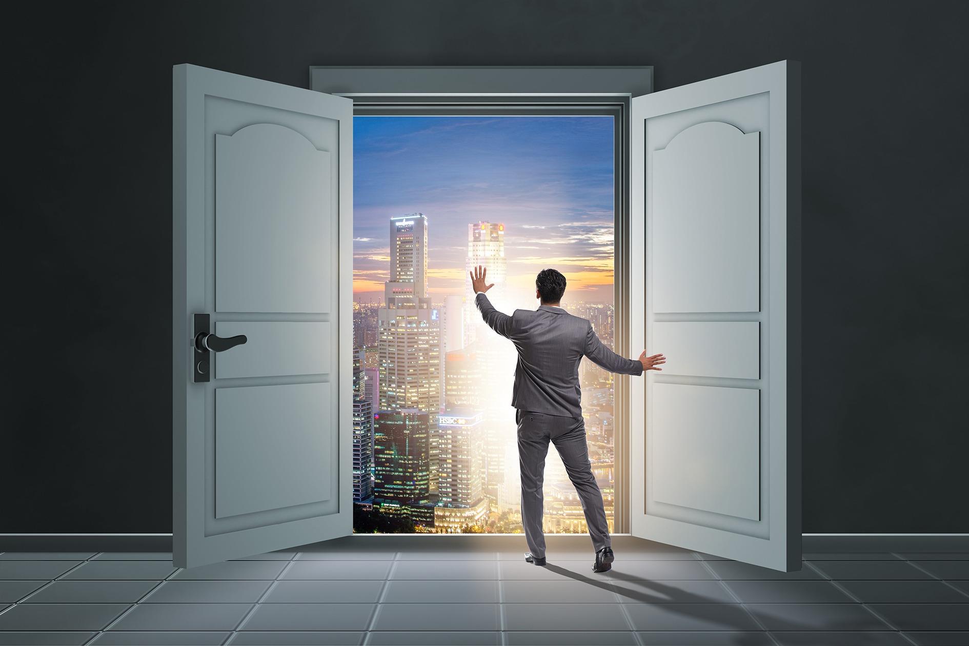 Guy standing next to open doors